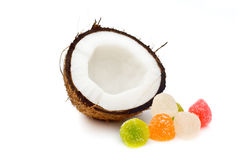 Halved coconut with jelly candies Royalty Free Stock Images