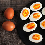Halved  Eggs on wooden  background closeup Royalty Free Stock Photography