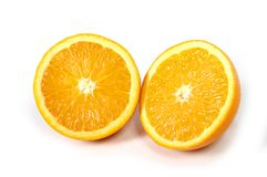 Halved fresh and healthy Orange Fruit isolated white Stock Image