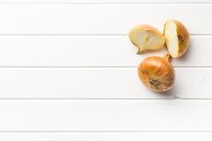 Halved fresh onion on kitchen table Stock Photo