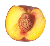 Halved fresh peach isolated with clipping path. Royalty Free Stock Photos