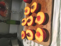 Halved fresh peaches Royalty Free Stock Photography