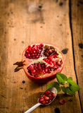 Halved fresh pomegranate with seeds Stock Image