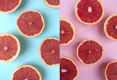 Halved grapefruit on pastel blue background stock photo