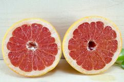 Halved grapefruit on a table Royalty Free Stock Image