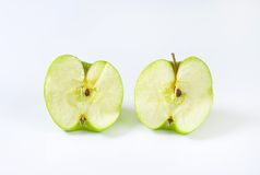 Halved green apple Royalty Free Stock Image