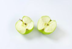 Halved green apple Stock Image