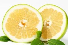 Halved green grapefruit Royalty Free Stock Photo
