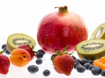 Halved Kiwi Fruits And Berries On White Background Royalty Free Stock Images