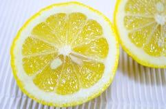 Halved lemon on a white cardboard close up Royalty Free Stock Photos