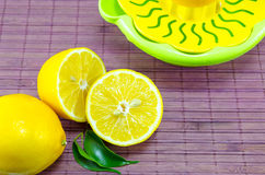 Halved lemons and a colander Stock Image