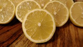 Halved Lemons on wood cutting board Stock Images
