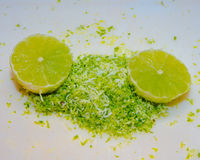 Halved Lime with grated lime zest. Closeup of halved limes with zest Stock Photos