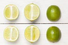 Halved limes. Stock Photos