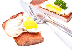 Halved meat loaf with fried egg Royalty Free Stock Images