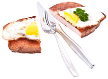 Halved meat loaf with fried egg Stock Image