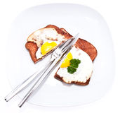 Halved meat loaf with fried egg Stock Photos