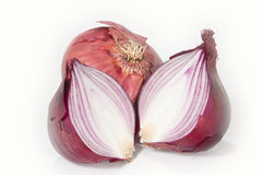 Halved onion. One halved an one closed onion isolated on white background stock photos