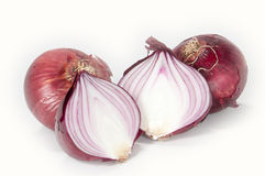 Halved onion. One halved an two closed onions isolated on white background stock image