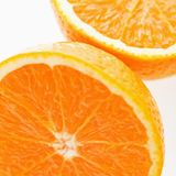 Halved orange. Stock Photos