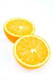 Halved orange. A pair of halved orange sections on white Stock Photo