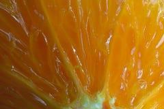 Halved orange close up. Background Royalty Free Stock Photos
