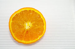 Halved orange on a white cardboard Stock Photography