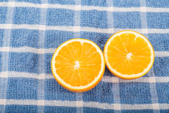 Halved Oranges on Blue Towel Royalty Free Stock Image