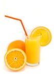 Halved oranges and orange juice Royalty Free Stock Image