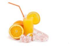 Halved oranges and orange juice Royalty Free Stock Images
