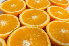 Halved oranges , sliced orange fruits closeup Stock Photos