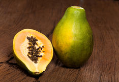 Halved papaya fruit Royalty Free Stock Photos