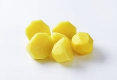Halved peeled potatoes Stock Photos