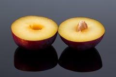 Halved plum Stock Images