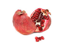 Halved pomegranate Stock Images