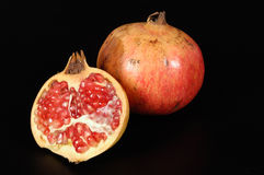 Halved pomegranate with interior view of seeds Royalty Free Stock Photography