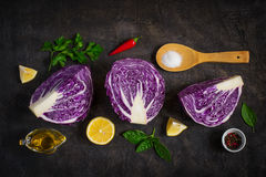 Halved red cabbage on dark background. Royalty Free Stock Photos