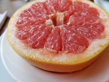 Halved red grapefruit closeup stock photo
