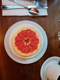 Halved red grapefruit closeup royalty free stock photography