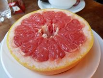 Halved red grapefruit stock photo