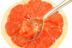 Halved red grapefruit with spoon isolated Stock Photo