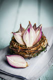 Halved red onions in a basket Royalty Free Stock Photos