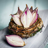 Halved red onions in a basket Stock Photo