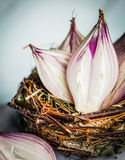 Halved red onions in a basket Royalty Free Stock Images
