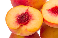 Halved ripe peach Stock Photos