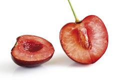 Halved ripe sweet cherry against white background Stock Photography