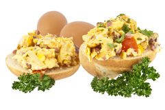 Halved roll with scrambled eggs Stock Photography