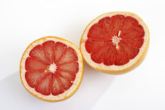 Halved ruby grapefruit Royalty Free Stock Photo