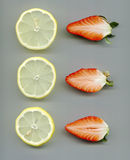 Halved strawberries and lemon slices Royalty Free Stock Photography
