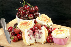 Halved Strawberry Cherry Muffin Surrounded By Fruit And Muffins Stock Photo